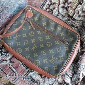 Louis Vuitton wrist bag.